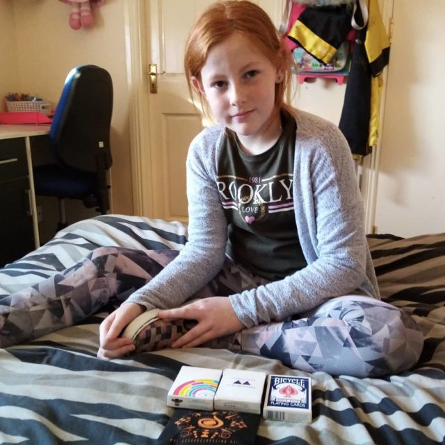 Jessica enjoying her cards from #cascadejuggling and today she is starting to get the false shuffle ricksmithjr posted. #cardistry #beginner #havingfun #cards #bicyclecards